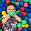 baby-playing-with-ball